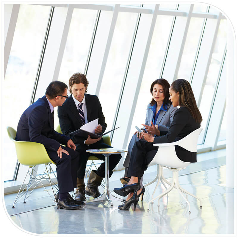 A meeting with business people viewing and discussing reports