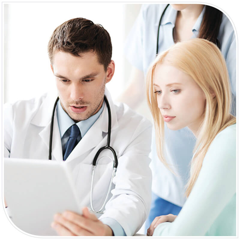 Healthcare provider viewing going over data sheets with a patient
