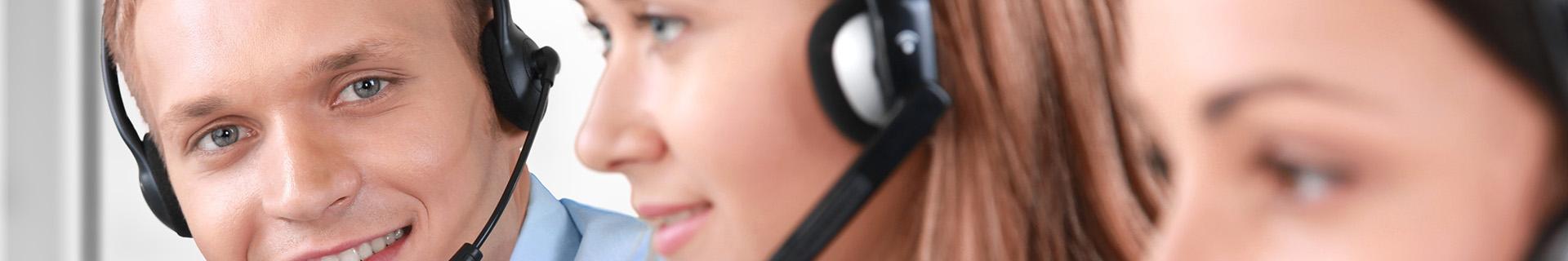Customer service representitives smiling at work