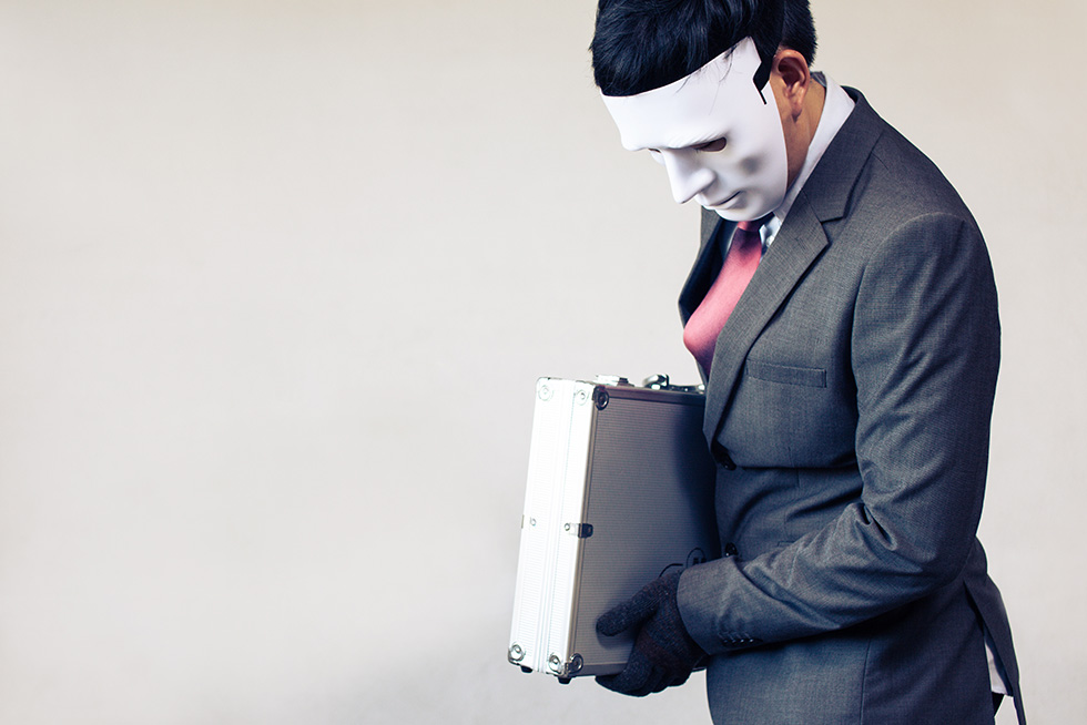 Masked man carries off briefcase