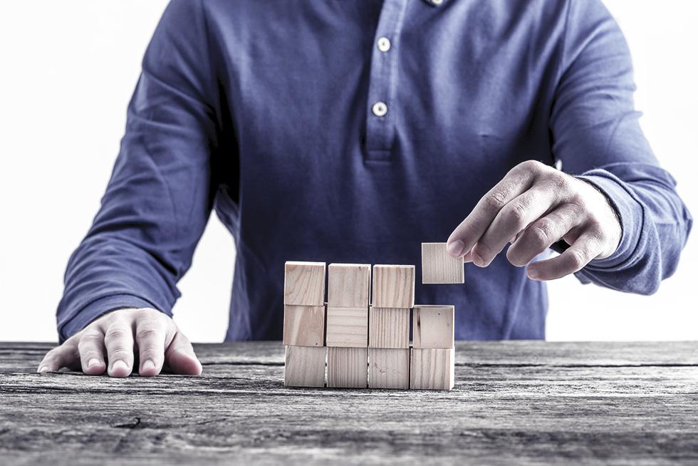A man using small building blocks