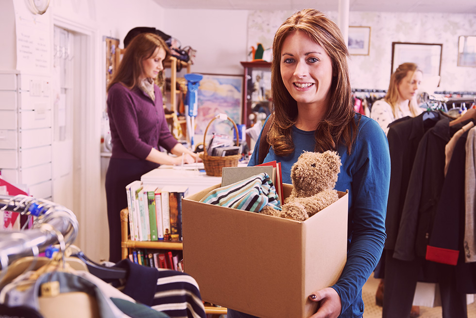 Woman donating a box of goods