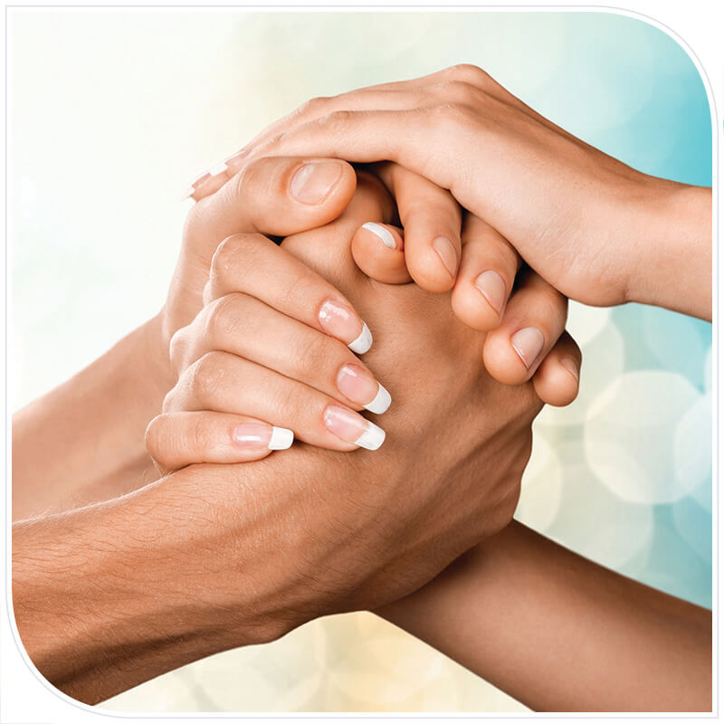 Two people joining hands in unity