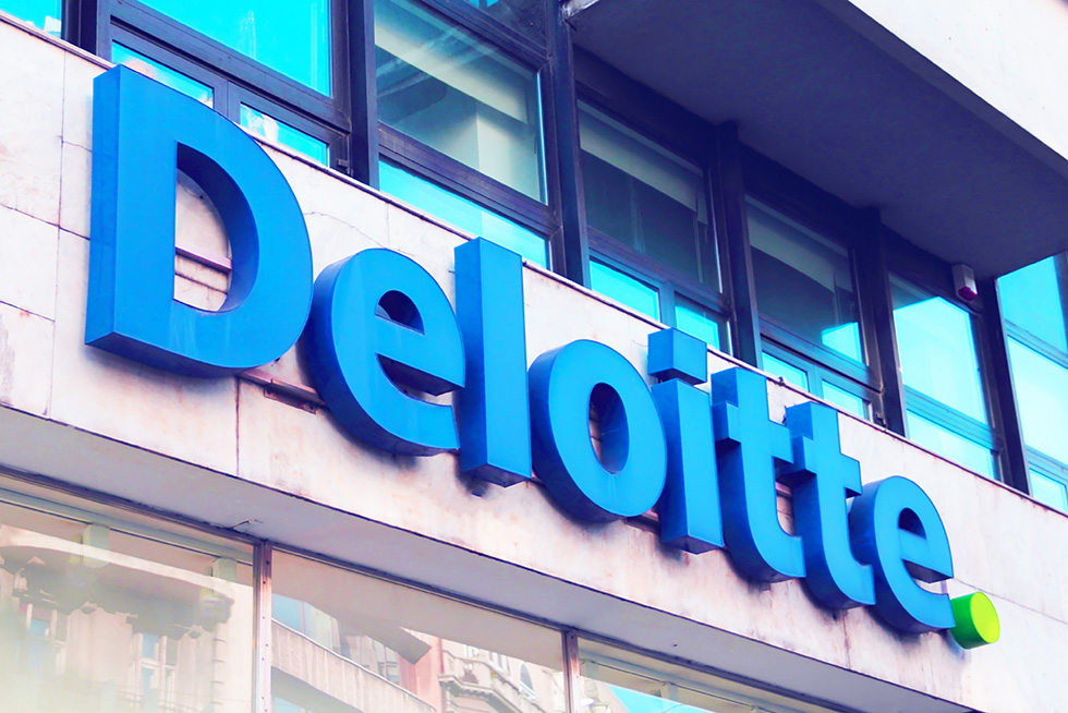 Deloitte's logo featured on the front of their building