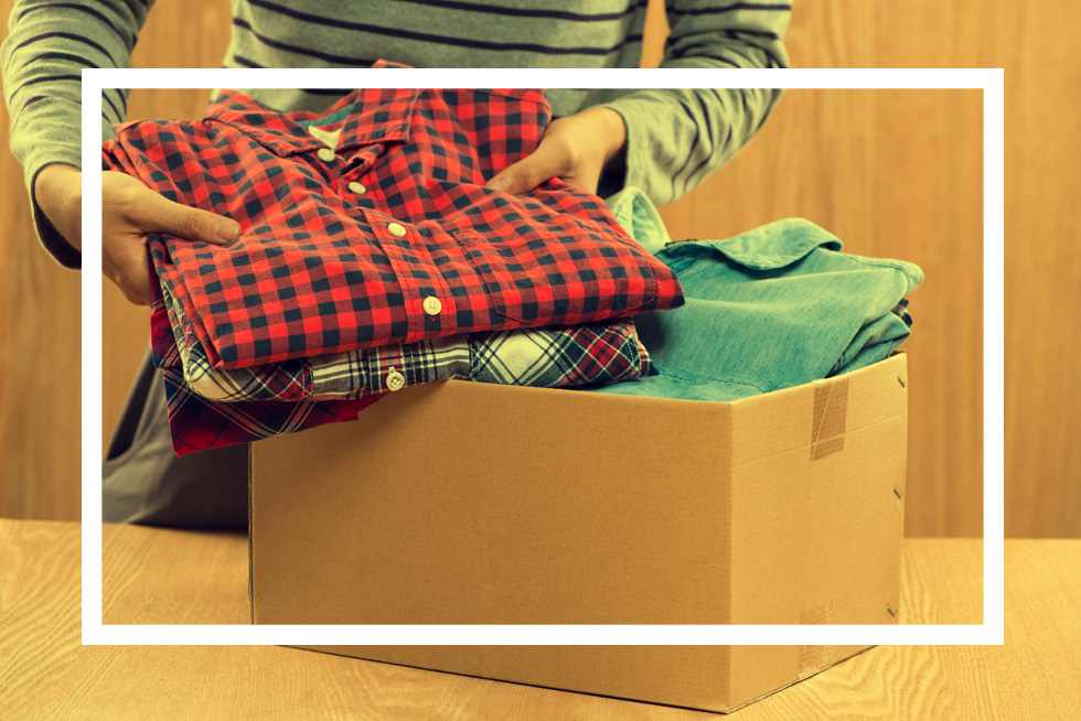 Clothes being packed into box for donation