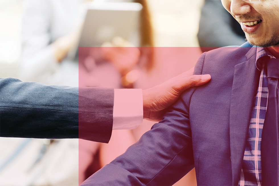 Closeup of businessmen greeting each other