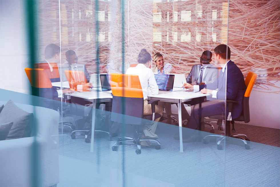 Businessmen and women meeting in a conference room