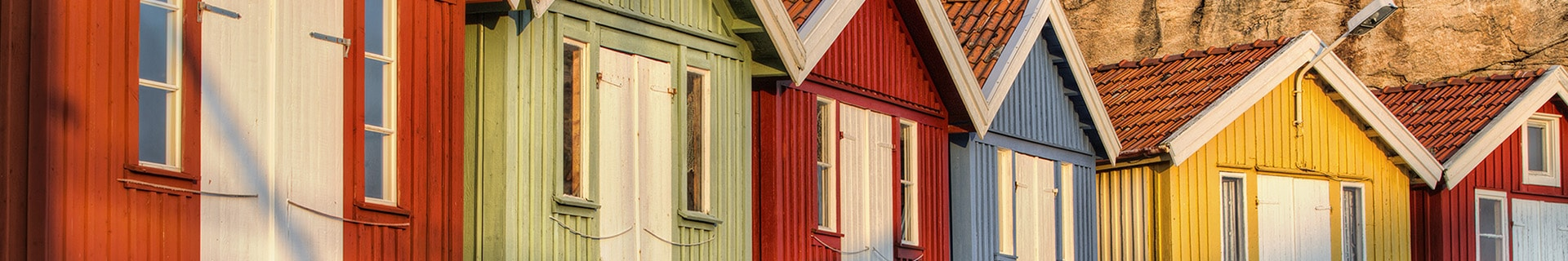 A row of identical houses with different color schemes