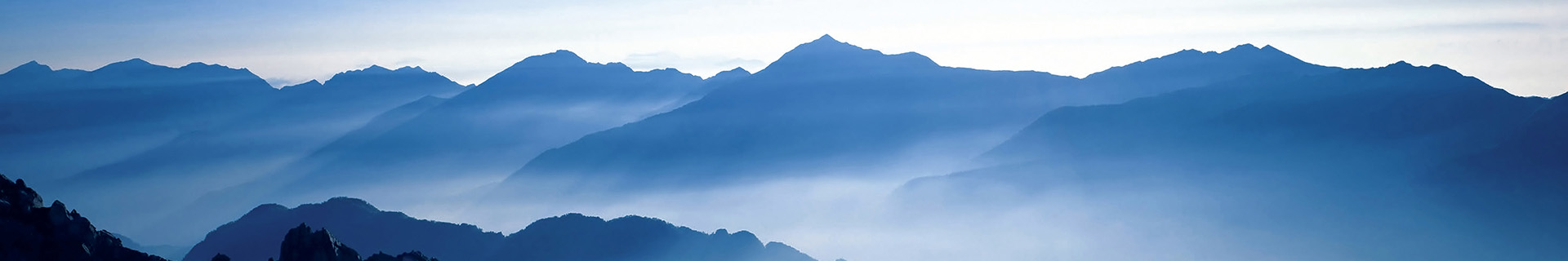 Early morning overview of a mountain range in a cloud